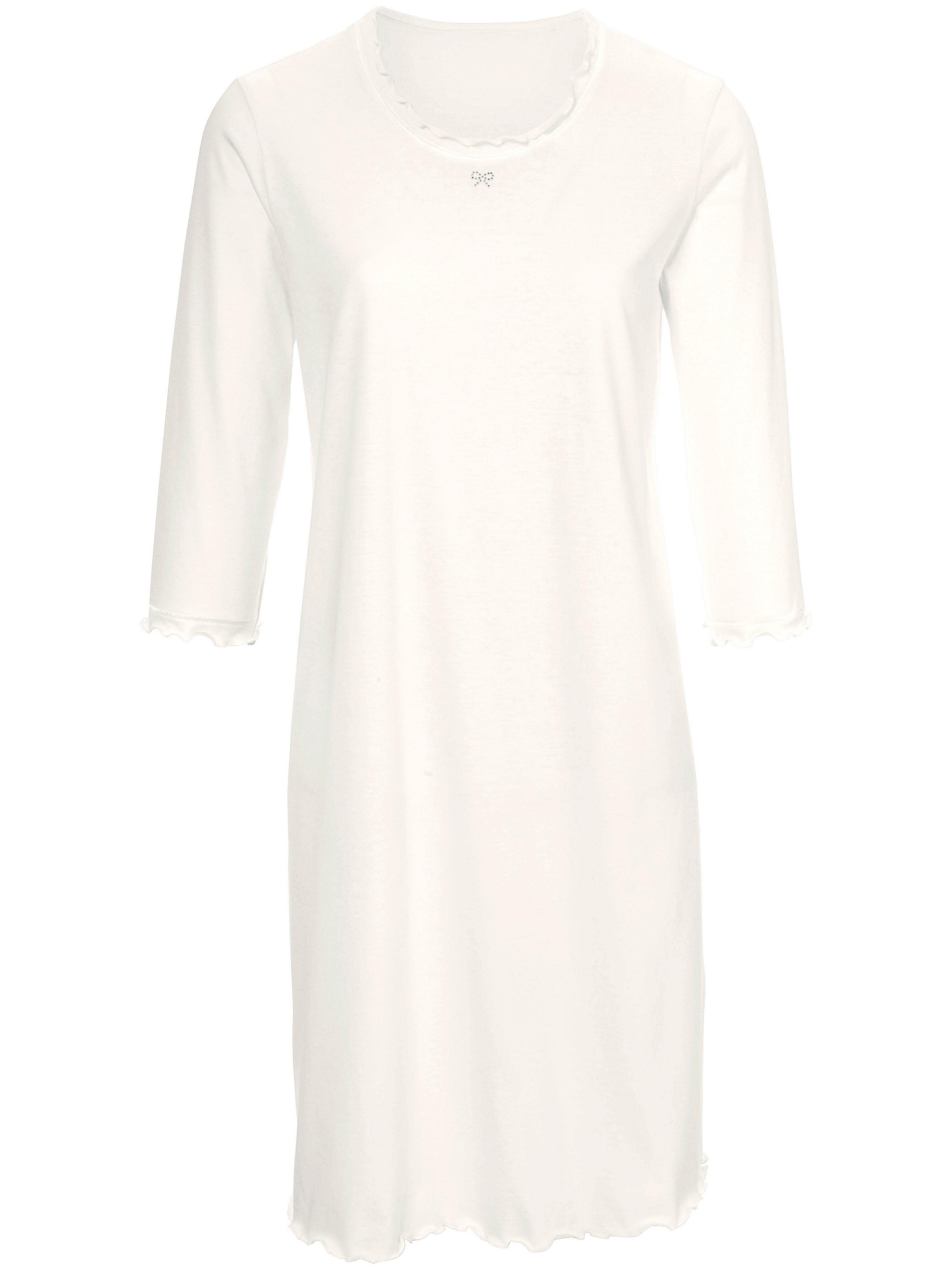 Artikel klicken und genauer betrachten! - Sleep-Shirt von Peter Hahn mit 3/4-Arm. Ganz puristisch und edel aus softem Single-Jersey. Ziersteppnähte, Glitzer-Schleifchen am Ausschnitt und französische Abschlüsse. 100% Baumwolle. Länge ca. 100cm. Dieses Sleep-Shirt ist maschinenwaschbar. Normalwaschgang 40°. Chlorbleiche nicht möglich. Nicht heiß Bügeln. Reinigung P. Trocknen im Tumbler nicht möglich. Farbe: Ecru. Erhältlich in den Größen: 42,44,46,48,52. Hochwertige Qualitätsmode für Damen ab 50 Jahren.   im Online Shop kaufen